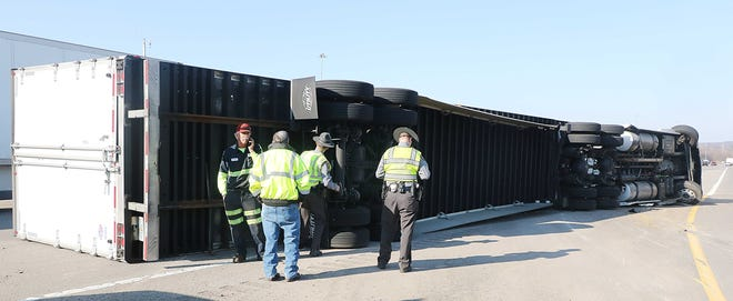 This tractor-trailer rollover on the I-71 northbound on-ramp from U.S. 30 eastbound in Richland County on Wednesday afternoon backed up traffic for miles. TONY ORENDER, TIMES-Gazette.COM