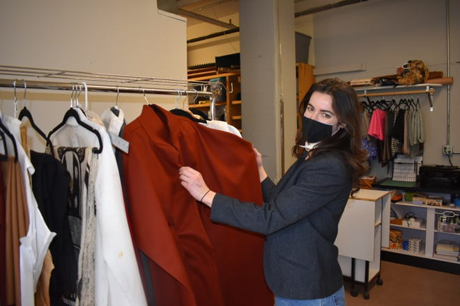 Janae Smith, the owner of Threadit, shows a cape she created that was recently featured in a fashion show.