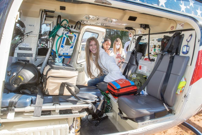 Lakeside High School student Amelia Oswald, 16, checks out the medical evacuation helicopter Thursday morning during the Columbia County Youth Leadership Day activities showing teens the consequences of texting and driving.