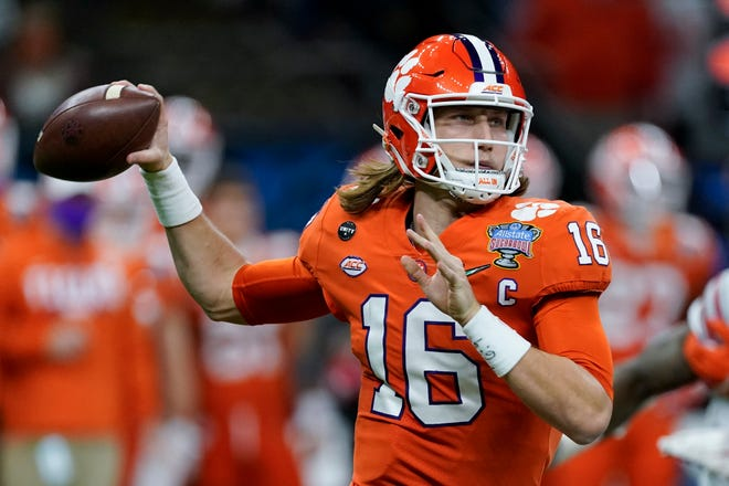 Clemson quarterback Trevor Lawrence passes against Ohio State during the first half of the Sugar Bowl in New Orleans on New Year's Day. The 2021 combine wasn't held in the traditional way, but NFL teams will draft beginning on April 29. Lawrence is expected to be the first pick, going to the Jacksonville Jaguars.