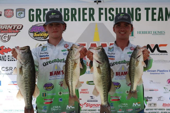 Greenbrier High's Jacob Hodge (left) and Henry Garrett show off their catch after winning the Georgia Bass Nation High School Tournament last Saturday on their home lake of Clarks Hill. Their fish weighed 20.15 pounds.