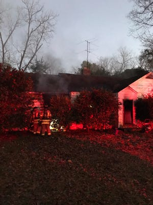 Augusta firefighters respond to a house fire on the 1000 block of Bluebird Road in Augusta, Ga. on March 3, 2021 that displaced two adults and three children.