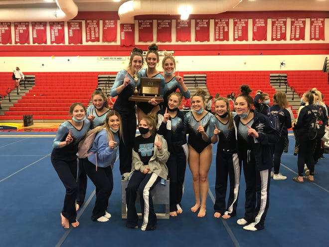 The Central Valley gymnastics team celebrates its first WPIAL championship at Moon High School on Friday, Feb. 26.