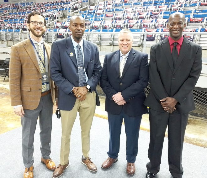 The West Central Basketball Officials Association crew of Greg Jefferson (second from left), Tommy Tilley (second from right) and Dee Brown (far right) officiated the Class C semifinal between top-ranked Gibsland-Coleman and fourth-seeded Reeves at the LHSAA girls' state tournament at Burton Coliseum on Tuesday. The trio is joined in the photo by Lee Sanders, the Louisiana High School Athletic Association Director of Officials.