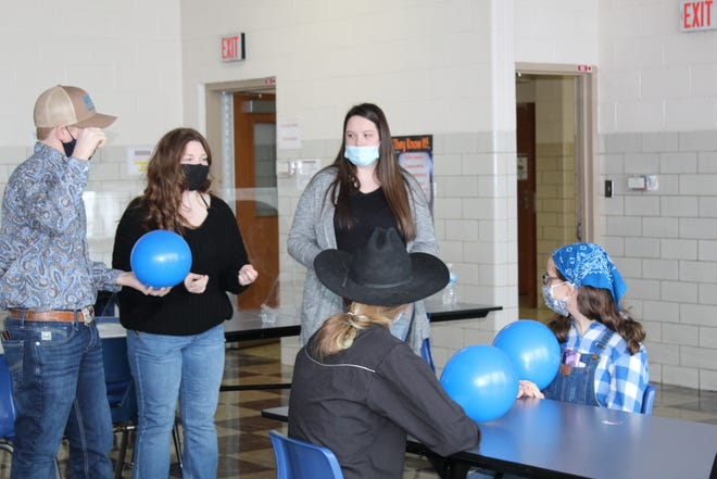 Union Local FFA Secretary Charlee Daugherty and Sentinel Adreanna Harper are pictured leading an activity.
