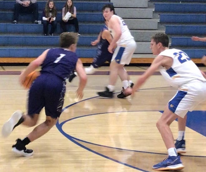 Booneville senior Austin Hill (1) makes a move to the basket against Bergman's Kaden Ponder (23) during the second half of Booneville's regional game at Bergman on Wednesday. Hill led the Bearcats with 18 points, but Booneville's season was ended with an 89-69 defeat.
