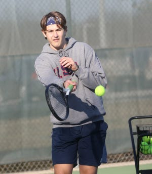 Boonville senior tennis player Gabe Greis hits a forehand during practice Monday at the high school tennis courts.