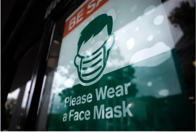 A COVID-19 safety sign last year in Austin. With the statewide mask mandate ending next week, businesses across Texas must now decide whether to require customers to wear face coverings in their establishments.