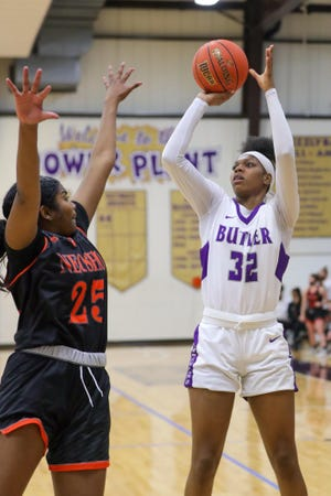 Butler's Tamara Nard (32) attempts a shot of Neosho County's Rajon Callahan (25) on Wednesday, March 3 at the Power Plant in El Dorado, Kansas. The Sophomore had 21 points in the record setting 120-56 win.