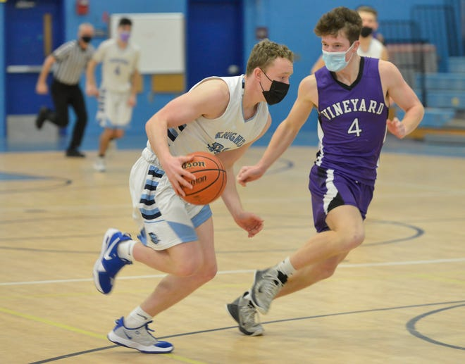 Sandwich's Christopher Cronin, left, heads down the court followed by Martha's Vineyard's Leo Neville during a game last month. Cronin led Sandwich to the Cape & Islands  Atlantic regular-season crown, and his performance throughout the season earned him Most Valuable Player honors.