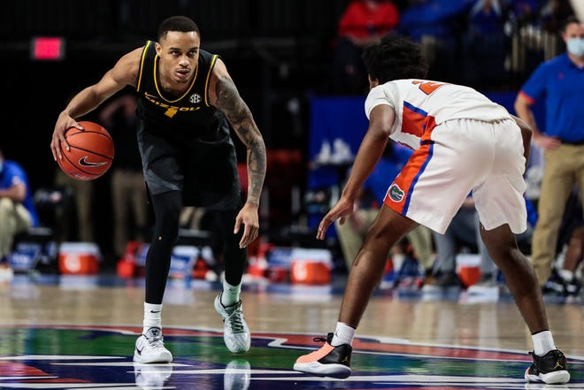 Missouri guard Xavier Pinson (1) dribbles the ball against Florida on March 3 at Exactech Arena in Gainesville, Fla.