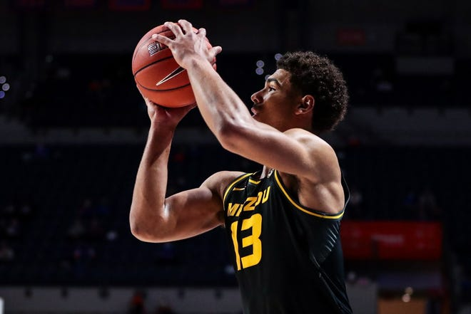 Missouri guard Mark Smith (13) shoots the ball during a game against Florida on March 3 at Exactech Arena in Gainesville, Fla.