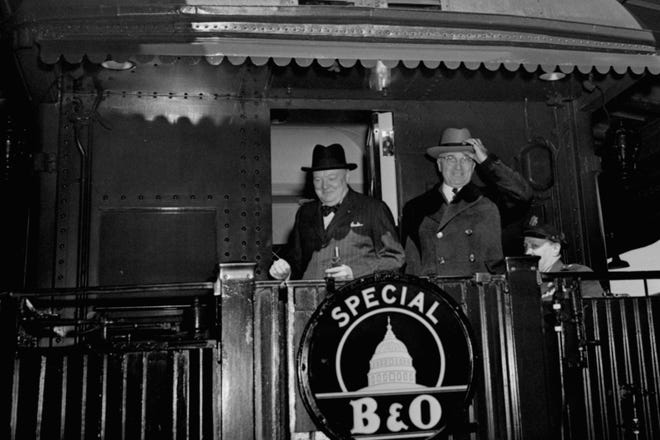 """FILE - In this March 4, 1946 file photo, British Prime Minister Winston Churchill, left, and President Truman wave from the President's special train as they leave Washington, for Fulton, Mo., where Churchill will speak at Westminster College. During the speech, Churchill used the term """"iron curtain"""" as a metaphor for the growing Soviet influence over the wreckage of post-World War II Europe. (AP Photo/File)"""