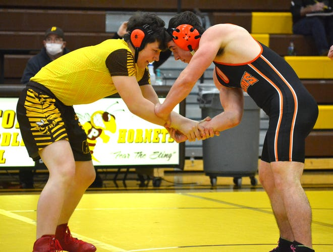 Pellston sophomore William Kline (left) battles with Rogers City's Jake Pomranke during a 171-pound bout in a wrestling quad match held in Pellston on Wednesday.