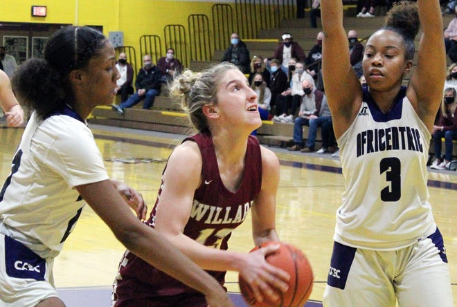 Willard's Mckenna Stephens goes up for a shot against Maliyah Johnson, left, and Lyric Ransom of Africentric in the Nubians' 54-50 overtime win in a Division III regional semifinal.