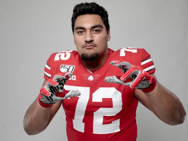 Ohio State Buckeyes defensive lineman Tommy Togiai was among 14 former Ohio State players to receive invitations to the NFL scouting combine.  [Joshua A. Bickel/Dispatch]