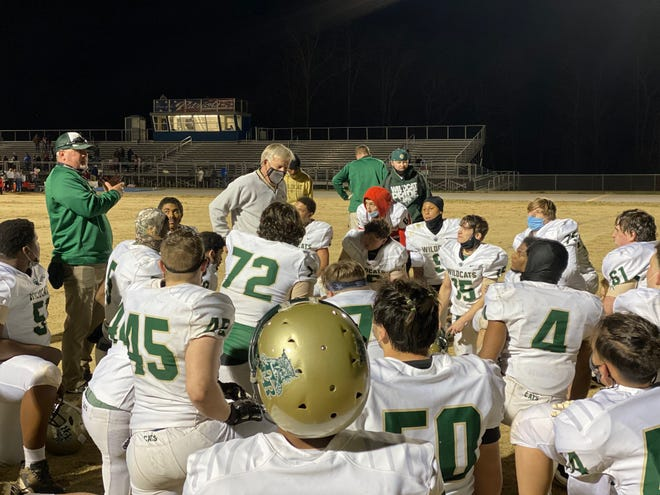 Eastern Randolph coach Burton Cates talks to his team after the Wildcats beat Providence Grove 22-14 on Wednesday. [Susan Chappell for The Courier-Tribune]