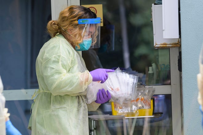 Health care workers conduct testing for COVID-19in 2020 at the WIC office in Umatilla. [Cindy Peterson/Correspondent]