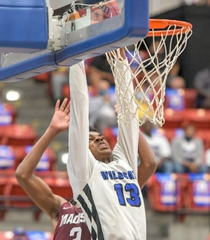 Wildwood's Joe Poyser (13) dunks in Wednesday's Class 1A state semifinal against Madison County at the RP Funding Center in Lakeland. The Wildcats will play Milton Central Friday for the state championship. [PAUL RYAN / CORRESPONDENT]
