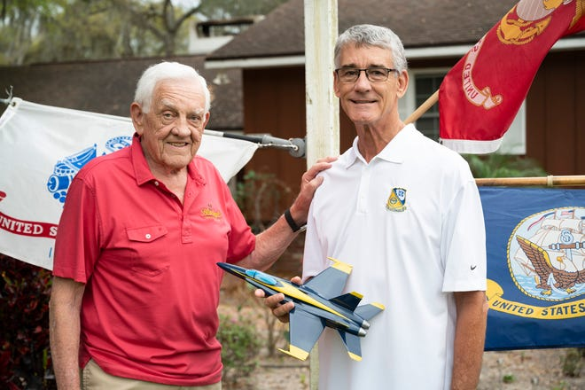 Navy Commander Wayne Molnar, right, and his father, Gene, a retired lieutenant colonel in the Marine Corps.