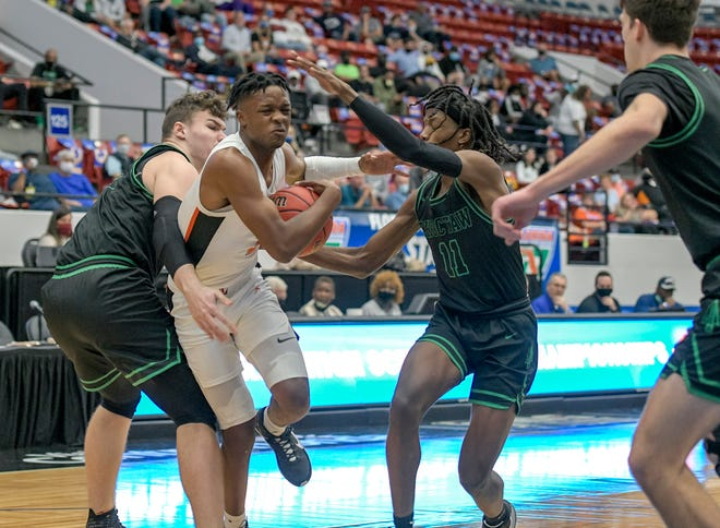 Leesburg's Camerin James (2) drives through a triple team during Thursday's Class 5A state semifinal game Fort Walton Beach Choctawhatchee at the RP Funding Center in Lakeland. [PAUL RYAN / CORRESPONDENT]