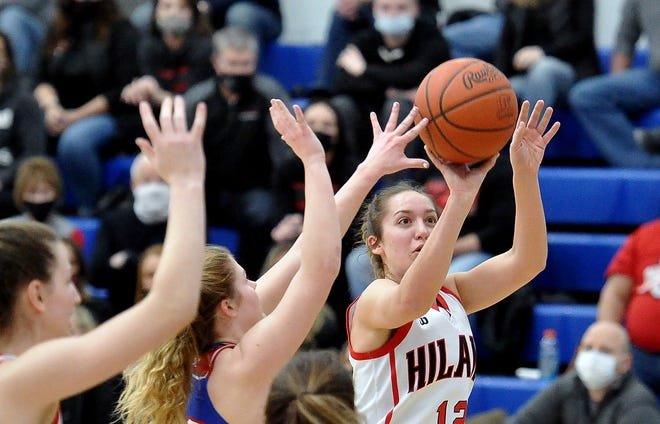 Hiland Morgan Yoder shoots in a crowd.