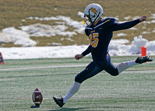 Siena Heights kicker Alec Thelen kicks off in a game against Concordia during the 2021 season.
