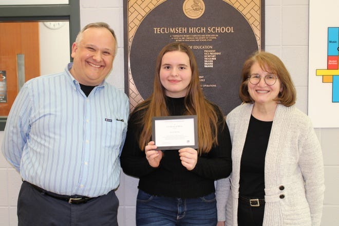 Parents, Ross and Kara Roesch, with their daughter, Tecumseh High School senior Anne Roesch, who is a finalist for the 2021 National Merit Scholarship.