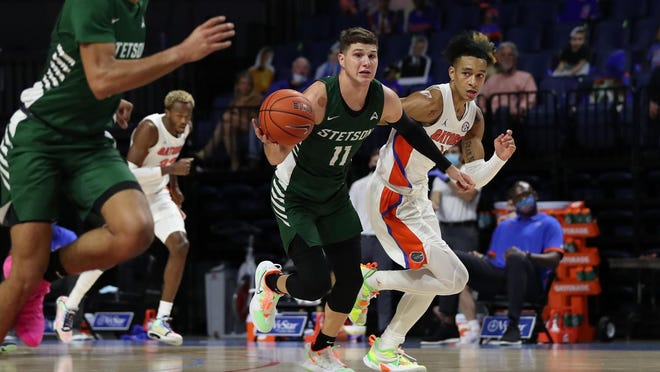 Stetson freshman Chase Johnston (11) has been named ASUN Freshman of the Year for the 2020-21 season, in voting by conference's head coaches.