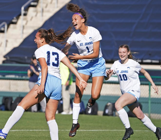 St. Johns Country Day's Mia Sadler (13), Lauryn Mateo (1) and Lauren Weiss (10) celebrate a goal during the FHSAA Class 2A girls soccer championship.