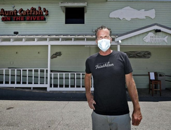 "Brendan Galbreath, owner of Aunt Catfish's on the River in Port Orange, stands in front of his family business in June 2020. The coronavirus pandemic caused a 50% decline in sales in 2020. ""I'm cautiously optimistic that we're positioned for success in 2021, at least as much as we can have given the pandemic,"" he said on Thursday, March 5, 2021."