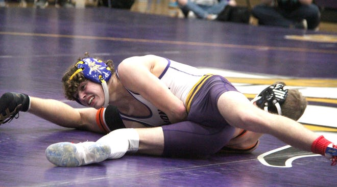 Bronson's Perry Lake closes in on a pin fall victory as he stacks up his Leslie opponent Wednesday