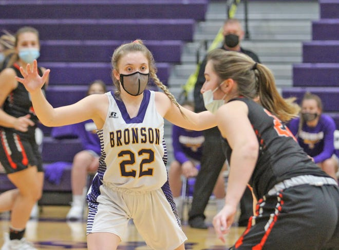 Bronson's Jadyn Cary (22) shown here in early season action helped lead the Lady Vikings to a romp of Bellevue Wednesday