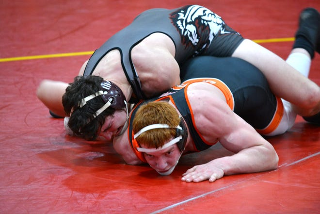 Union City's Garrett Iobe battles Quincy's Gerl Pish in the matchup of the night as two highly ranked wrestlers did battle. Pish went on to win via decision.