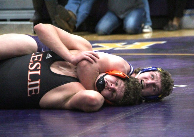 Bronson senior Justin Blankenship eyes the official to see if he's getting his near fall points Wednesday versus Leslie.