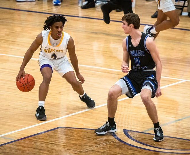 Blue Springs point guard Kyle Bruce, left, brings the ball down court against Grain Valley's Keagan Hart (11) in Tuesday's Class 6 District 14 semifinal. The junior is what makes the Wildcats' explosive offense go.