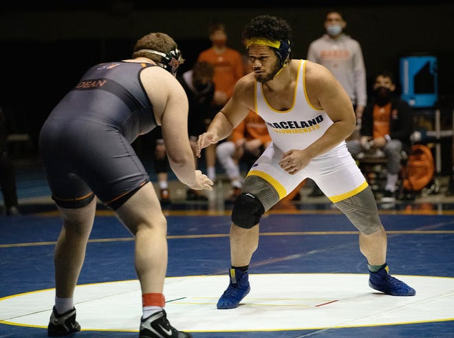 Graceland University sophomore wrestler David Toese, right, used the motivation of just missing a berth for the NAIA National Championships last year to earn a spot in the 285-pound weight class this season. The former William Chrisman High School state champion was aided by training with his older brother Dominic, also a Graceland teammate.