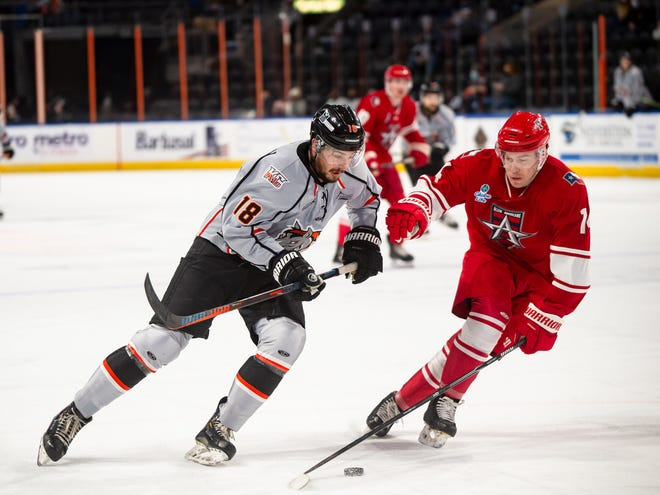 Kansas City Mavericks veteran forward Darik Angeli (18) drives to the net in a game against the Allen Americans earlier this season. Angeli was named ECHL Player of the Week after tallying nine points in four games last week.