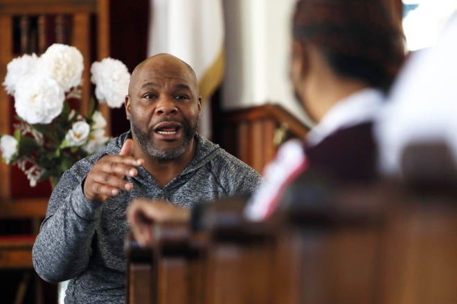 The Rev. Rob Brown, president of Burlington, Iowa, Black Leadership Council, speaks to his fellow BLC members Feb. 27 during a meeting at Hope Temple Christian Church in Burlington.
