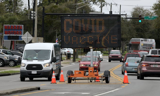 A large sign on Brentwood Blvd. announces the vaccine site at the Gateway Town Center Wednesday morning. Active duty Navy personnel man the large event tents set up to house the new Federal COVID-19 vaccination site at the Gateway Town Center on Jacksonville, Florida's Northside Wednesday March 3, 2021.