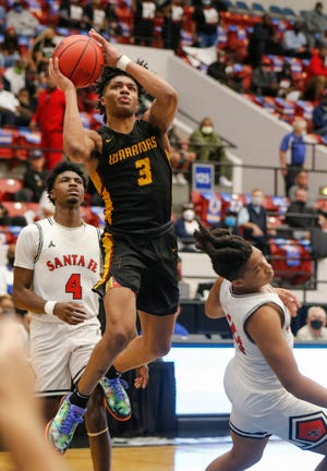 West Nassau's Dallan Coleman (3) shoots over Santa Fe's defense in the FHSAA Class 4A semifinals. Coleman was selected Friday as the state's Mr. Basketball, only the third Northeast Florida player ever to win that award.