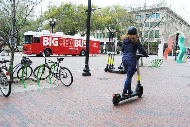 E-scooters like these from four companies are now permitted to operate in downtown Jacksonville.