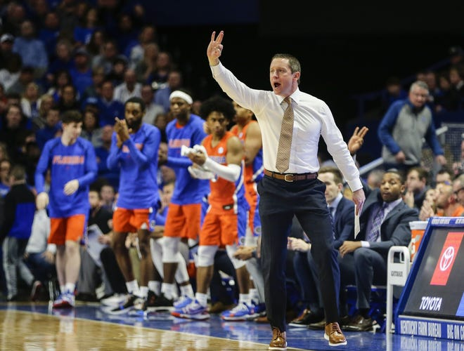 Florida basketball coach Mike White, seen here on the sidelines in a victory against Kentucky at Rupp Arena, has done one of his better coaching jobs in bringing the Gators back from the medical ordeal of losing star player Keyontae Johnson into fourth place in the SEC.