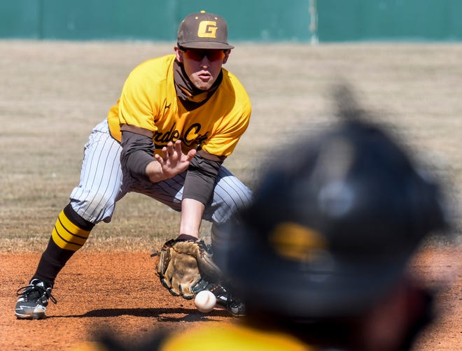 Garden City Community College third baseman Nico Vite scoops up a Colby grounder and throws to first base for an out Saturday at Williams Stadium.