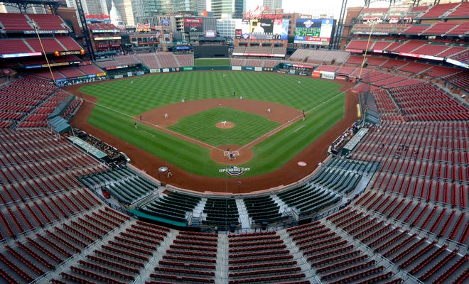 Empty seats are viewed in Busch Stadium as St. Louis Cardinals starting pitcher Jack Flaherty throws in the first inning of a July 24, 2020 game against the Pittsburgh Pirates in St. Louis.