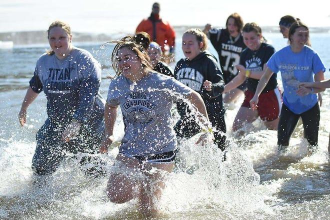 Team Titans make a splash at the 2020 Polar Plunge at Lake Storey.