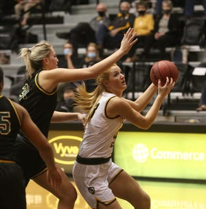 Fort Hays State's Olivia Hollenbeck looks to score inside against Missouri Southern's Madi Stokes on Wednesday in Gross Memorial Coliseum.