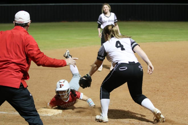 Pottsboro's Emily Pittman picks up one of her three steals during the Lady Cardinals win at Howe in the District 11-3A opener.