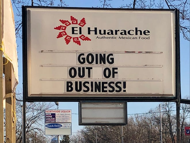 """A sign outside El Huarache on Butternut Drive in Holland Township announces the restaurant is closing. An employee later said the sign was meant to """"get people to come in."""""""