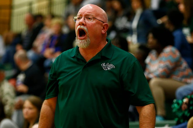 East Henderson Eagles head coach John Johnston yells out in the first half against the North Henderson Knights at East Henderson High School.